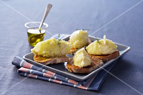 Bread topped with brandade and olive oil