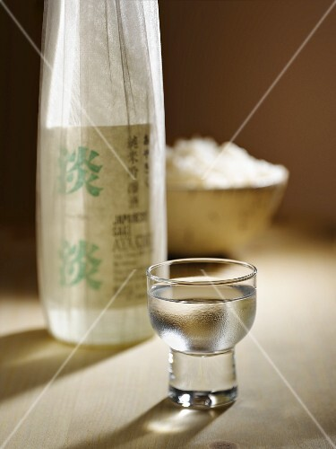 Glass of Sake with Sake Bottle and a Bowl of Rice