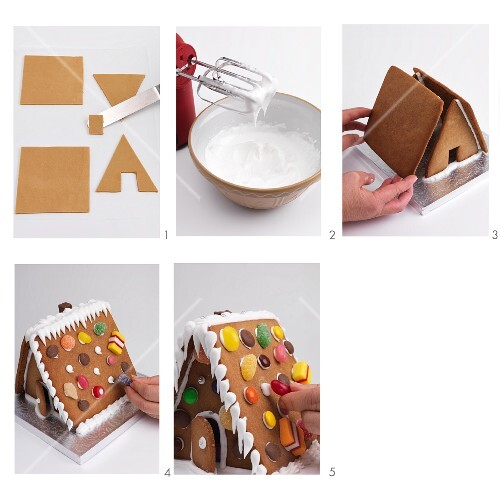 A gingerbread house being made