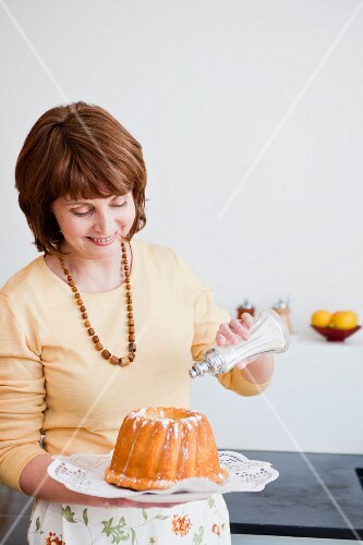 woman in kitchen preparing cake