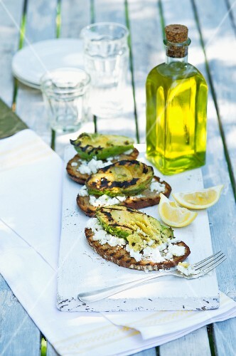 Grilled avocado with feta cheese and bread