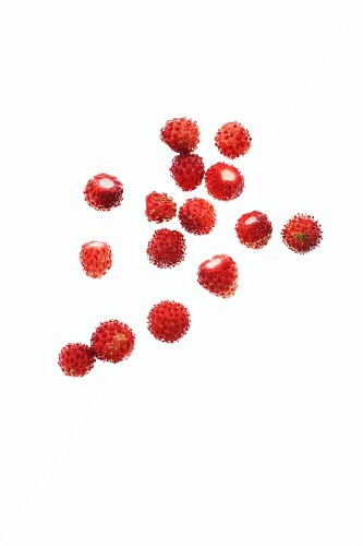 Wild strawberries on a white surface