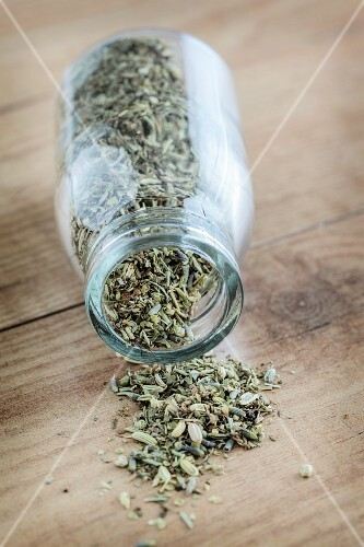 Herbs de Provence falling out of a jar