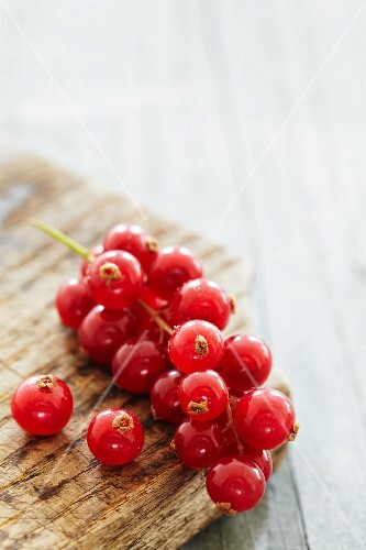 Redcurrants on a wooden surface