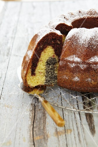 A marble Bundt cake with poppy seeds