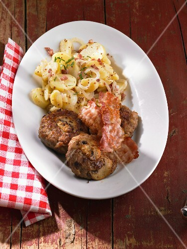 Meat balls with mushrooms, bacon and potato salad