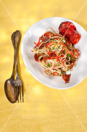 Chorizo chicken with noodles, peperoncini and lemon butter