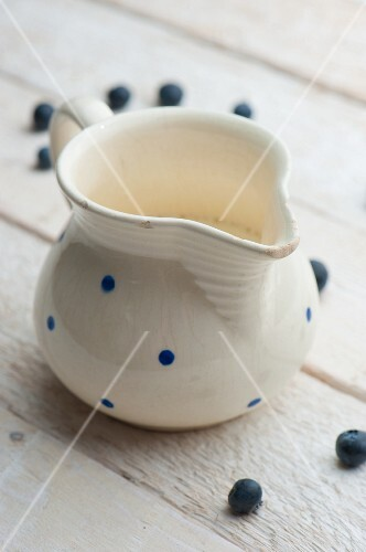 A jug of milk with blueberries