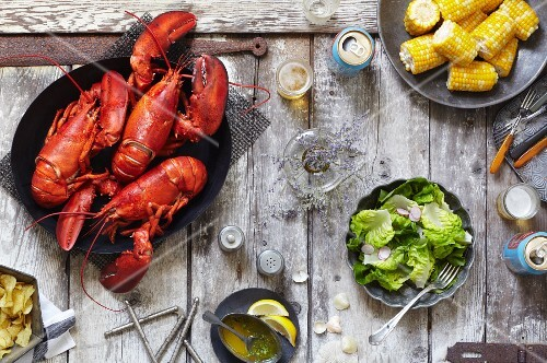 Boiled Lobster Dinner with Corn on the Cob Salad and Beer