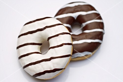 Two black and white doughnuts