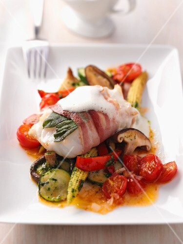 Cod saltimbocca on a bed of ratatouille