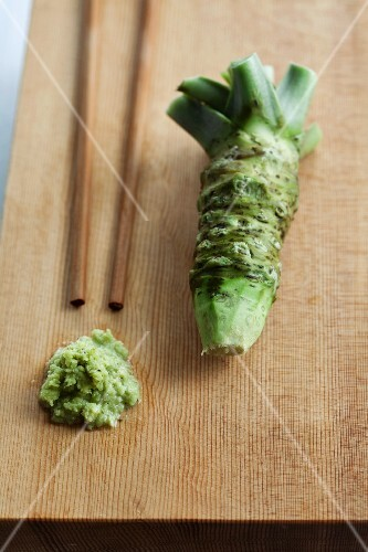 Wasabi, whole and grated, with chopsticks