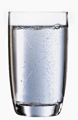 A glass of sparkling mineral water