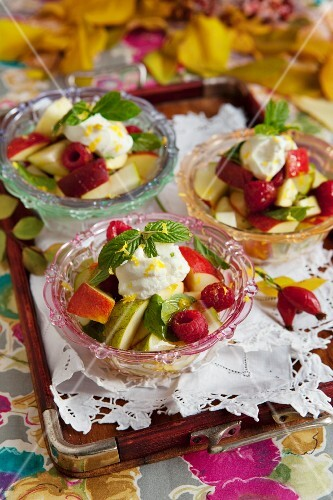 Fresh apple and raspberry salad with yoghurt and honey