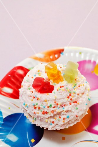 A cupcake topped with gummy bears