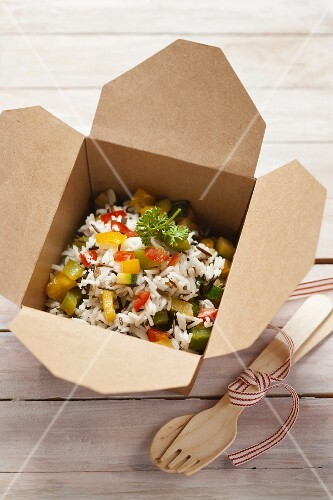 Rice with vegetables in a takeaway box