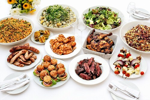 Sausages, chicken, couscous and salad on a buffet