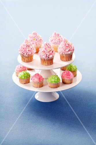 Cupcakes decorated with buttercream and sugar crystals on a cake stand