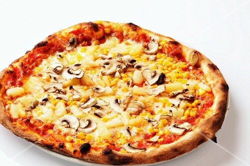 A pineapple, sweetcorn and mushroom pizza