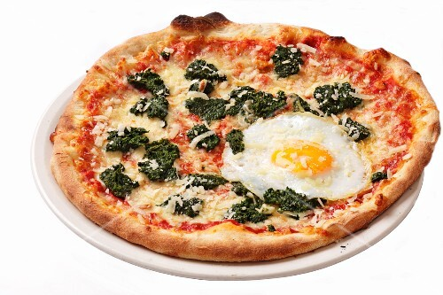 A spinach and fried egg pizza