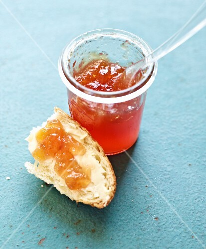 Quince jelly in a jar and on bread