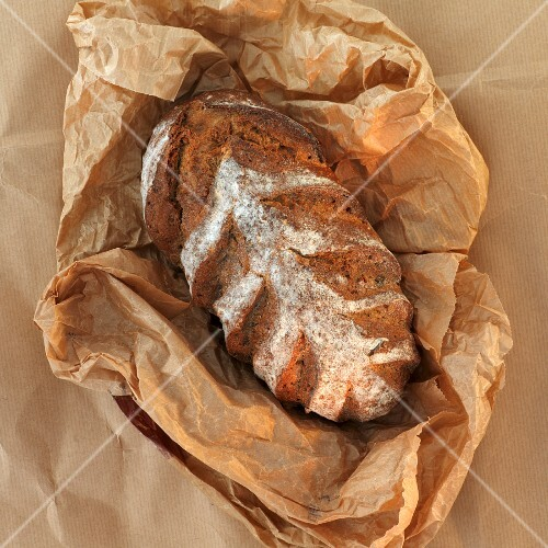 A loaf of bread on brown paper