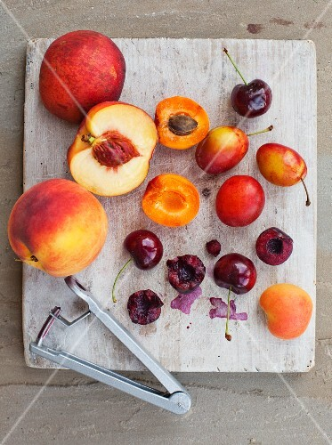 Summer fruits on a white wooden board