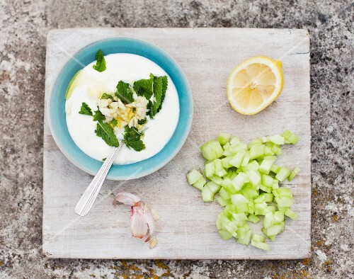 Cold yoghurt soup with herbs, garlic, cucumber and lemons