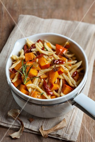 A pumpkin medley with pasta, dried tomatoes and porcini mushrooms