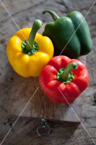 Three Holland Bell Peppers, Red, Yellow and Green