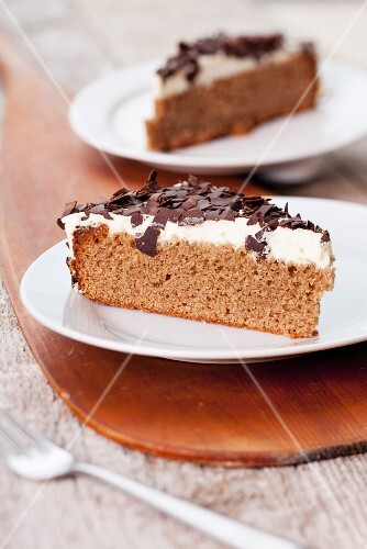 Two slices of nut cake garnished with grated chocolate