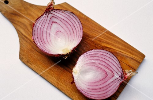 Sliced red onion on chopping board