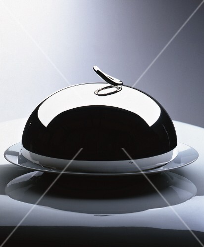 A cloche on a serving platter