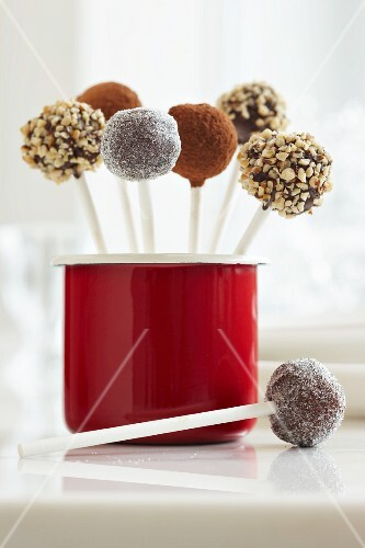 Cake pops with various topping: sugar, cocoa powder and nuts