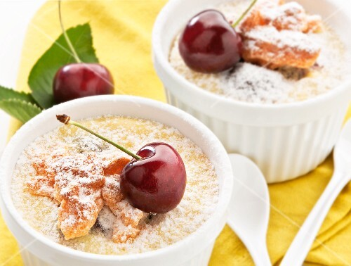 Rice pudding with cherries in ramekins