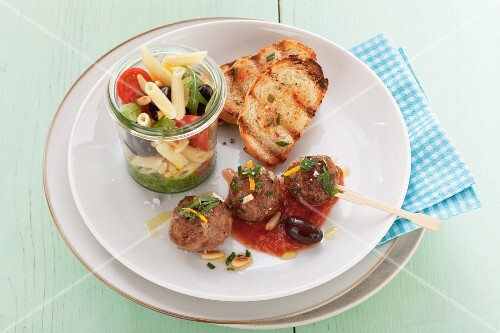 Meatballs, pasta salad and toasted bread