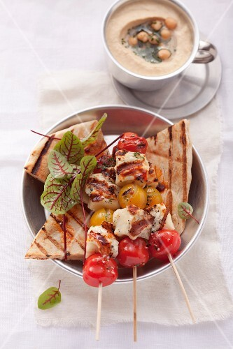 Grilled haloumi and tomato kebabs with unleavened bread and hummus