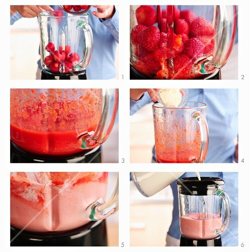 A strawberry milkshake being made
