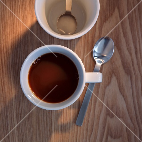 A cup of coffee with a coffee spoon