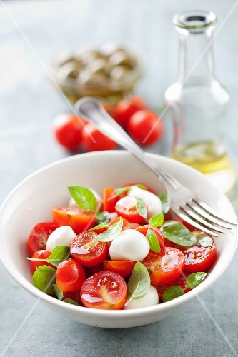 Tomato salad with mini mozzarella balls and basil
