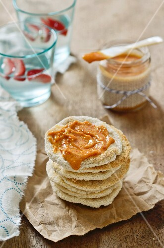 Peanut and chilli sauce in a jar and on unleavened bread