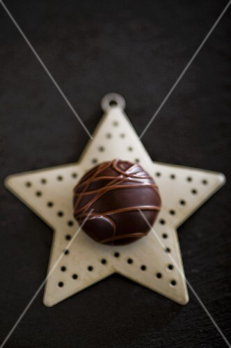 A chocolate praline on a Christmas star