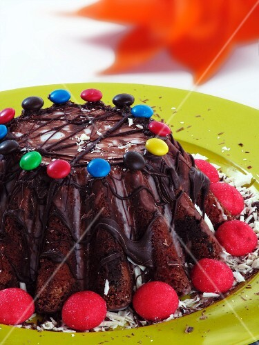 A chocolate caramel cake decorated with chocolate beans