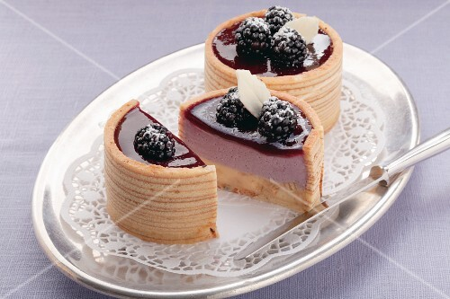 Small Baumkuchen (German layer cakes) filled with blackberry cream
