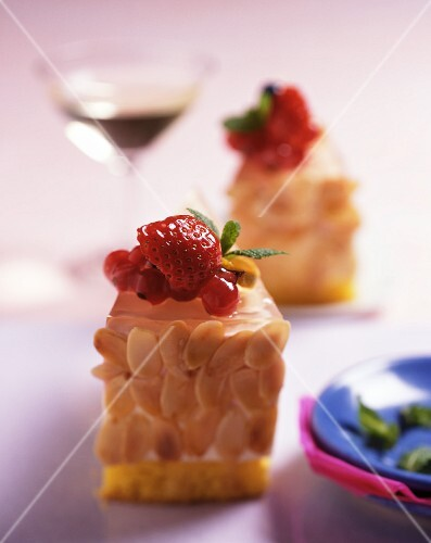 Almond gateau with berries, served with a glass of dessert wine