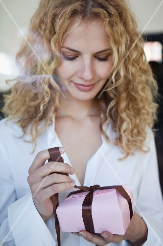 A woman unwrapping a box of chocolates