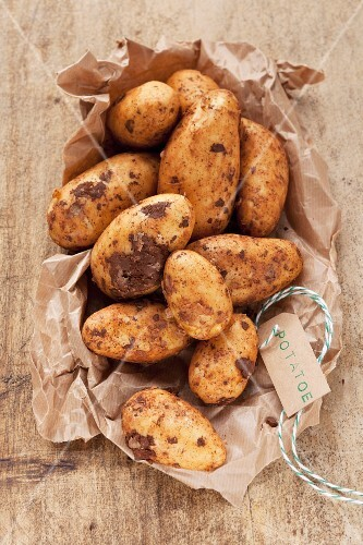 New potatoes on brown paper