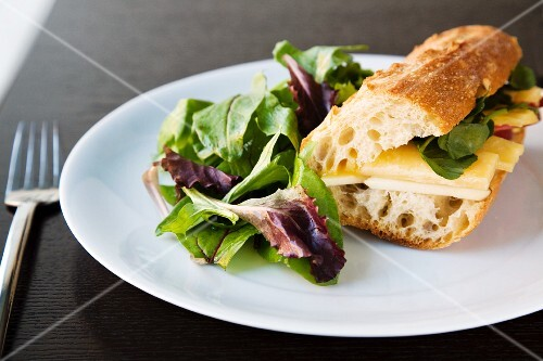 Apple and Cheddar Cheese Sandwich on a Baguette with Spinach; Side Salad