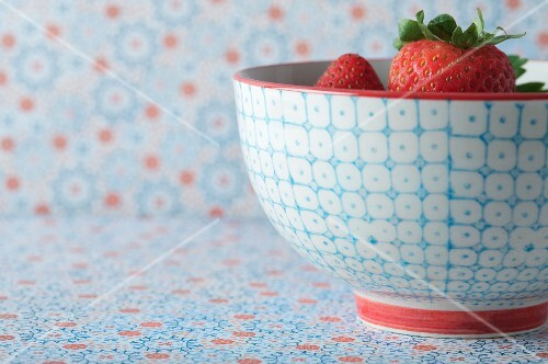 Fresh Strawberries in a Blue and White Bowl with a Red Rim