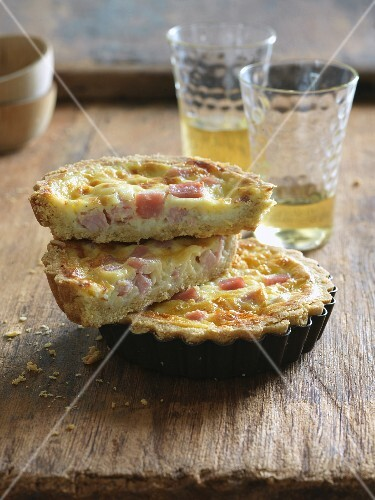 Halved Mini Quiche Lorraine Stacked on Whole Mini Quiche Lorraine